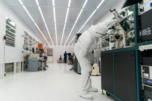 A graduate student at work in Rice University's clean room