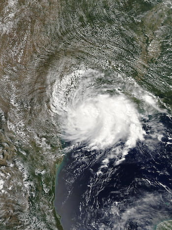 A satellite view shows Tropical Storm Imelda shortly after landfall near Freeport, Texas, on Sept. 17, 2019. (Credit: NASA)