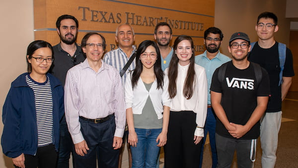 Members of the team that will continue to develop leadless, wirelessly powered pacemakers gathered at Texas Heart Institute. From left, front: Yang Zhao, Joseph Cavallaro, Yingyan Lin, Allison Post, Anton Banta; and back, Romain Consentino, Behnaam Aazhang, Dr. Mehdi Razavi, Mathews John and Yue Wang. Credit: Texas Heart Institute