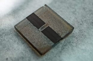 A sample all-inorganic perovskite solar cell is a step toward commercial use, according to scientists at Rice University. Their discovery of a way to quench defects in cesium-lead-iodide solar cells allowed them to preserve the material's band gap, a critical property in solar cell efficiency. (Credit: Jeff Fitlow/Rice University)