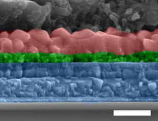 An electron microscope image shows a cross-section of the all-inorganic perovskite solar cell developed at Rice University. From top, the layers are a carbon electrode, perovskite, titanium oxide, fluorine-doped tin oxide and glass. (Credit: Lou Group/Rice University)