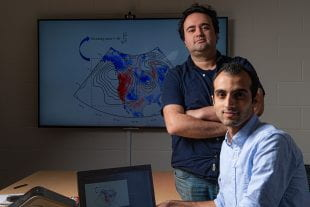 Rice University researchers Ebrahim Nabizadeh (seated) and Pedram Hassanzadeh