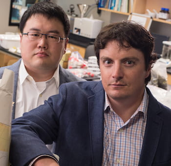 Rice University researchers Hongbo Ma, left, and Jeffrey Nittrouer, an assistant professor of Earth, environmental and planetary sciences, led a study that found a sharp break in the transport mechanism characteristics of sand and silt in riverbeds. (Credit: Jeff Fitlow/Rice University)