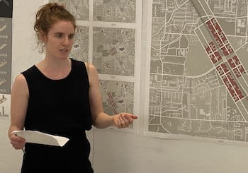 Vivian Schwab presents her thesis to a panel at Rice Architecture. Schwab went beyond theory to specifics in presenting a strategy to remediate the threat of fire to the city of Santa Rosa, California. (Credit: Rice University)