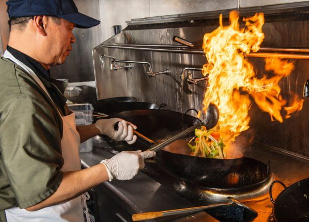 Andy Tat fires up lunch at Wok on Sunset in the North Servery. (Photos by Tommy LaVergne)