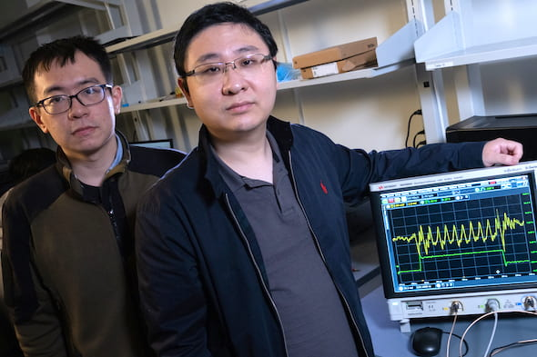 """Rice University graduate student Yan He, left, and Kaiyuan Yang, an assistant professor of electrical and computer engineering, will demonstrate their enhanced security strategy for the """"internet of things"""" at the International Solid-State Circuits Conference in San Francisco. (Credit: Jeff Fitlow/Rice University)"""