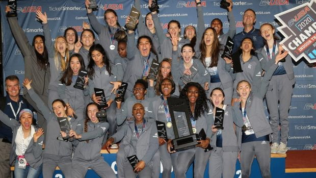 The Rice women's track and field team celebrates after claiming the Conference USA indoor championship Feb. 23 in Birmingham, Ala. (Conference USA photo)