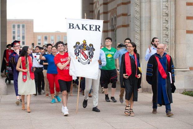Baker College seniors walk through the Sallyport during a mock graduation March 13, 2020.