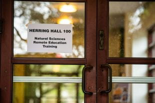 A sign indicates remote-learning training is underway at Herring Hall. (Photo by Jeff Fitlow)