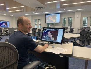 Rice Business staff prepare for the transition to remote learning at McNair Hall. (Photo courtesy of Rice Business)