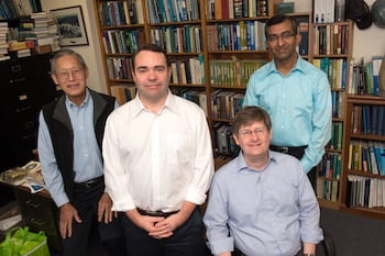 Rice University researchers — from left, George Hirasaki, Philip Singer, Walter Chapman and Dilip Asthagiri — have put to rest a long-held theory about the use of nuclear magnetic resonance to detect oil and gas deposits in the nanoscale pores of shale formations. Missing from the photo is the study's lead author, Arjun Valiya Parambathu. (Credit: Jeff Fitlow/Rice University)