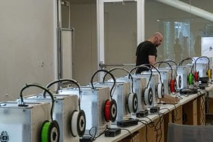 The Moody Center for the Arts has 15 additional 3D printers now running in its studio space, creating face shields under the supervision of Rob Purvis. (Photos by Jeff Fitlow)