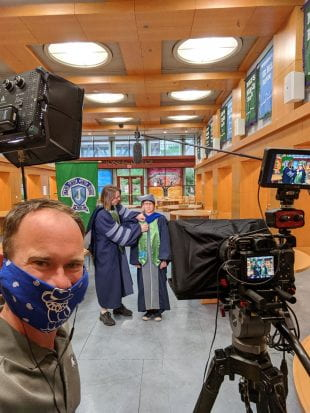 Brandon Martin sports a face mask while preparing to film Jones College magisters Jason Hafner and Jennifer Trotter.