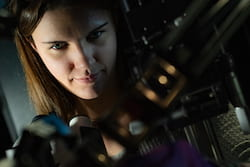 Rice University graduate student Lauren McCarthy led an effort that discovered details about a novel type of polarized-light matter interaction with light that literally turns end over end as it propagates from a source. (Credit: Jeff Fitlow/Rice University)