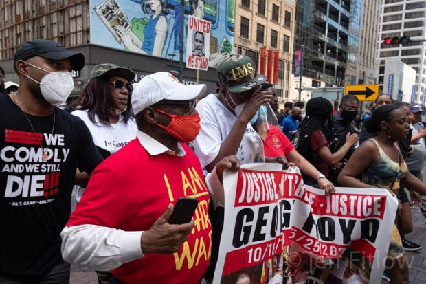 """Protestors at the """"Justice 4 George Floyd"""" march June 1 carry a banner in downtown Houston."""