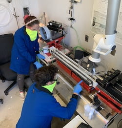 Rice University graduate students Lauren Taylor and Oliver Dewey work to refine the process of making threadlike fibers from carbon nanotubes. Their fibers now surpass the strength of Kevlar. (Credit: Pasquali Research Group/Rice University)