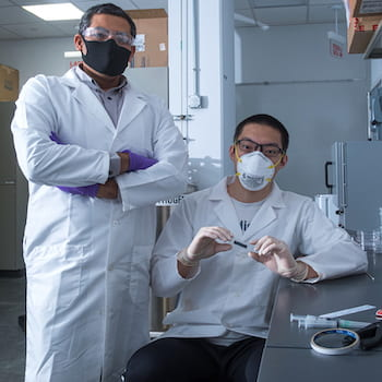 Rice University engineer Gururaj Naik and graduate student Weijian Li have discovered that 2D tantalum disulfide has unique light-handling properties that could be useful for 3D displays, virtual reality and self-driving vehicles. (Credit: Jeff Fitlow/Rice University)