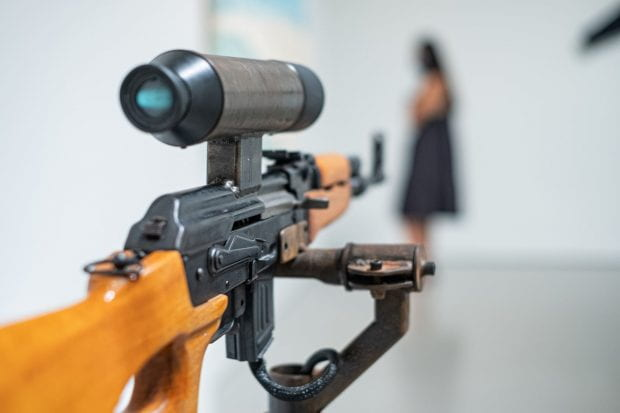 """America's Finest"" by Lynn Hershman Leeson is an interactive installation with video camera and AK-47. (Photos by Jeff Fitlow)"