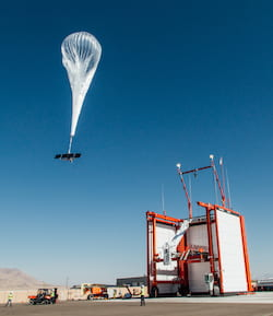 A Loon balloon lifts off. Atmospheric data collected by the internet satellites could help refine weather forecasts and inform studies of climate change. (Credit: Loon)