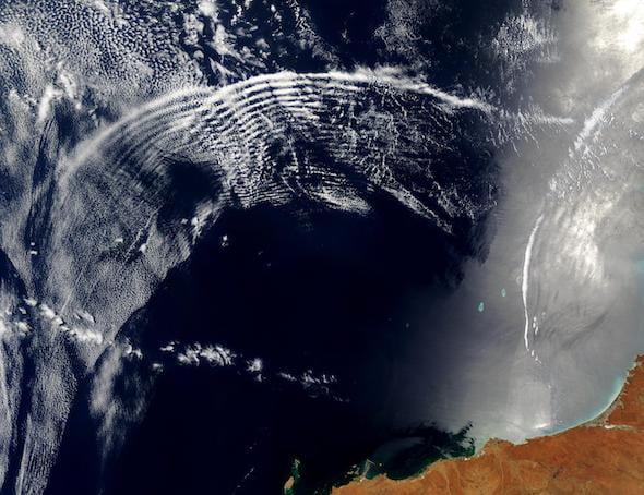 Gravity waves overlap over Australia in this NASA satellite image. Defining how atmospheric gravity waves influence weather and climate is the topic of a new study funded by the National Science Foundation. (Credit: Courtesy of NASA/Visible Earth)