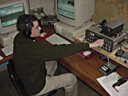 W5YM 2002-2003 club president, James Webster (KD5QYG) tunes up the primary HF rig during the fall contests in the temporary Shack location in BELL.