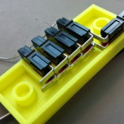 The connectors have been removed from the first shell and inserted into the other shell for soldering the opposite row of contacts.