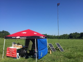 A shot of the ARCUA Field Day 2015 site, complete with solar panels and the Razorback flag flying atop the 50 ft. mast.