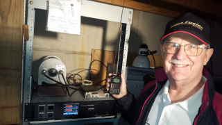 Murray, W5XH, poses with the new W5YM Yaesu DR-1X repeater system, installed in January 2016.