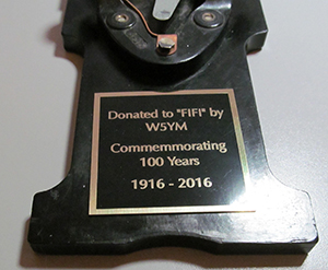 """The plaque attached to the authentic J-37 key donated to the Boeing B-29 Flying Superfortress """"FIFI"""" in 2016 to commemorate W5YM's 100 year anniversary."""