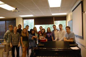 Thirteen of the sixteen a capella singers of Common Time rehearsed their set-list of songs sung during Common Hour on Sept. 19 in Grant Hall.