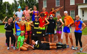 Members of the Cross Country team pose prior to the annual Theme Run through campus. The theme for this year was famous superheros