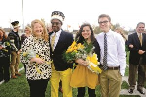 Seniors Emily Robbins, C.J. Donald, Jennifer Hormell, and Hormell's brother David all celebrate Donald and Hormell's Homecoming win.