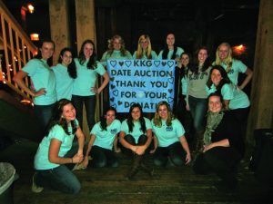 Women of Kappa Kappa Gamma posed after last year's Date Auction to give thanks to those student who participated in both the date and silent auctions.