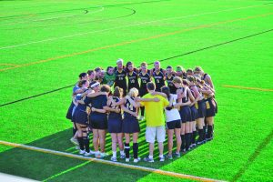The Centre Field Hockey team huddles together before a game against Roanoke on Sep. 6. The team finished the year with a 16-5 overall record and made it to the Sweet 16 of the NCAA Tournament