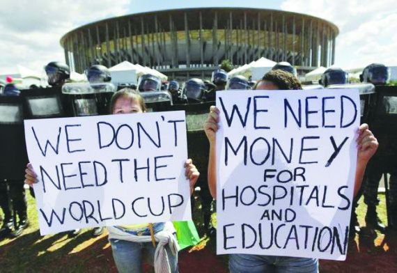 Protesters express their opinion about the Brazilian government spending the country's money on building new stadiums for the World Cup.