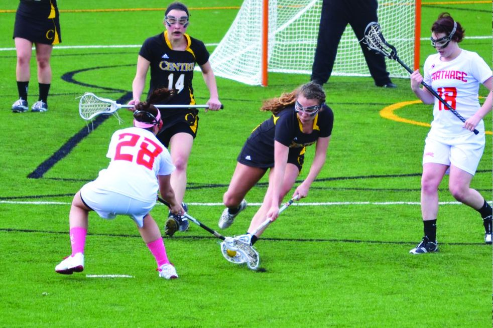 Senior midfielder Sarah Mastey battles a Carthage defender for a loose ball during action from the 2013 campaign.