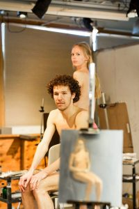 Juniors Teddy Jablonski and Mattthew McCurdy pose during a nude modeling session in the art barn during weekly drawing sessions.