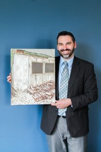 Dr. Matthew Klooster displays his oil paintings, which are inspired by the landscapes that he comes across while simply driving in his car.