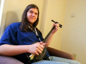 Junior Nick Teale sits with his shamisen, one of the instruments that he has used in order to record the songs of his concept music album, which consists of two separate movements.