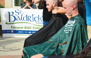 Students sign up each year to get their heads shaved in an effort to raise money for the St. Baldricks Foundation. The event is hosted by the Phi Kappa Tau fraternity.