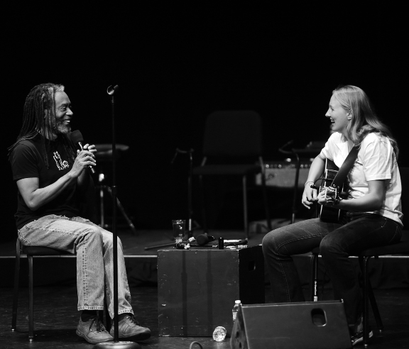 First-year Riley McCormick improvs alongside Bobby McFerrin at a demonstration before McFerrin's performance at the Norton Center
