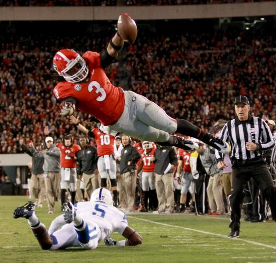 University of Georgia running back Todd Gurley hurdles a defender during a touchdown run.