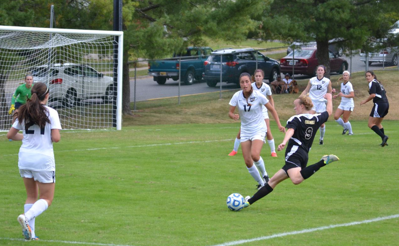 Junior midfielder Alex Combs takes a shot at goal in an earlier match in the 2014 season. Combs has two goals and two assists in 12 games.