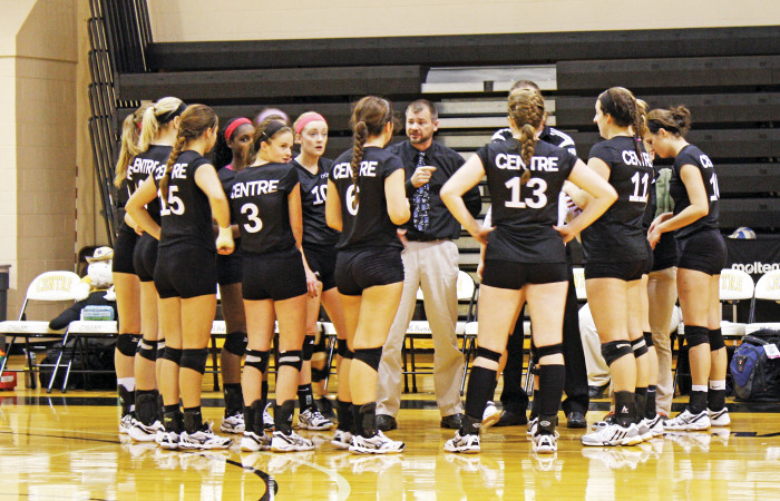 Centre Volleyball huddles up for a timeout in a home match this year. They have five conference games remaining in the 2014 season.