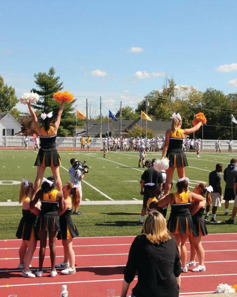 The Centre Cheerleading team performs for the crowd during a home Football game. They will also be cheering at the home Basketball games.
