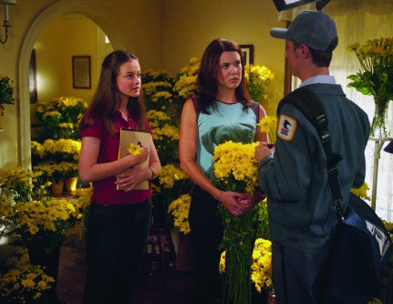 Alexis Bledel, left, and Lauren Graham, center, as Rory and Lorelai Gilmore on Gilmore Girls. All seven of the show's seasons are now on Netflix.