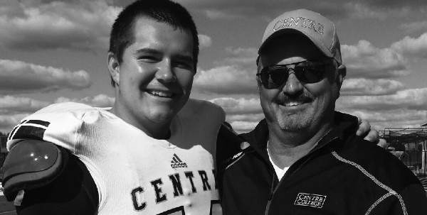 Sophomore offensive lineman Hunter Trenamen poses for a photo with his father after a home Football game during the 2014 season.
