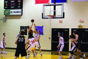 Junior forward Tyler Wesley goes up for a layup at the team's recent game against the Millsaps Majors. Wesley recorded five blocks during this game as part of the Colonels strong defensive outing.