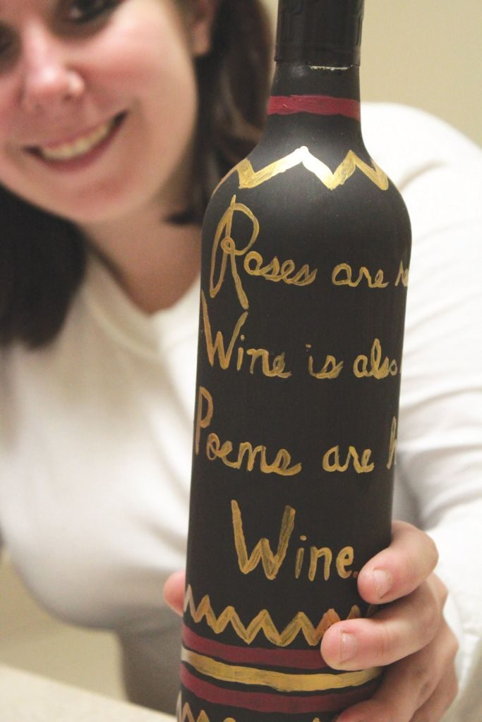 Painted wine bottles are a versatile decoration because they can be customized to be sassy, elegant and can be showcased whereever
