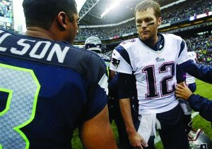 Seahawks Quarterback Russel Wilson and Patriots Quarterback Tom Brady exchange words after the Seahawks suffered a devstating loss.